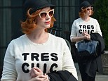 Tres Chic! Christina Hendricks channels the 1920s in a cloche hat but adds a modern twist with a high street sweater
