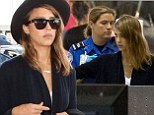 Jessica Alba gets hand searched by the TSA as they ask her to put her hands up and above her head.