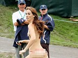 Victory: A streaker runs on the 18th hole during the Day Four Singles Matches at the Muirfield Village Golf Club on October 6, 2013 in Dublin, Ohio as American Captain Fred Couples (second from right in baseball cap watches)