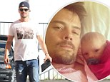 Father-son tradition starts now! Doting new dad Josh Duhamel shares snuggly snap of he and baby Axl watching football together