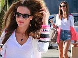 Hair raising! Alessandra Ambrosio's locks get blown around by a gust of wind as she displays her endless legs in denim cut-offs