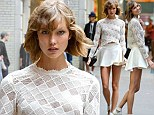 Never a dull moment: Supermodel Karlie Kloss shoots fashion editorial spread in the middle of busy New York street