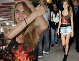 How Cara got her groove back: Ms Delevingne heads to Samba school and shows her moves in denim shorts
