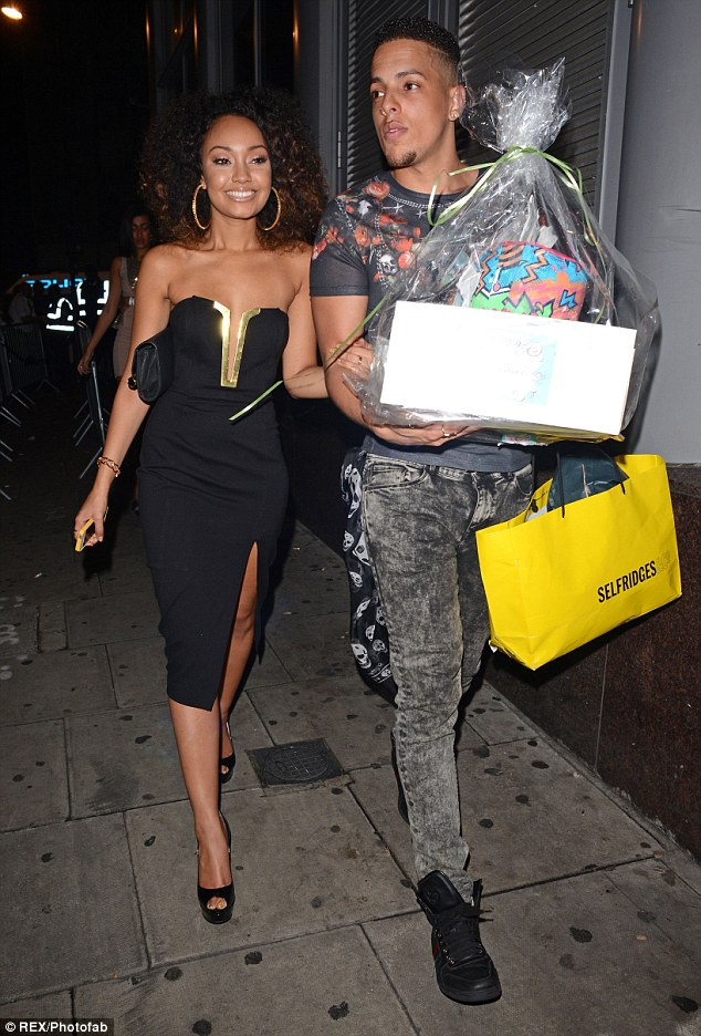 Lucky girl: Leigh- Anne's friend carried a number of gifts for her as they strolled along