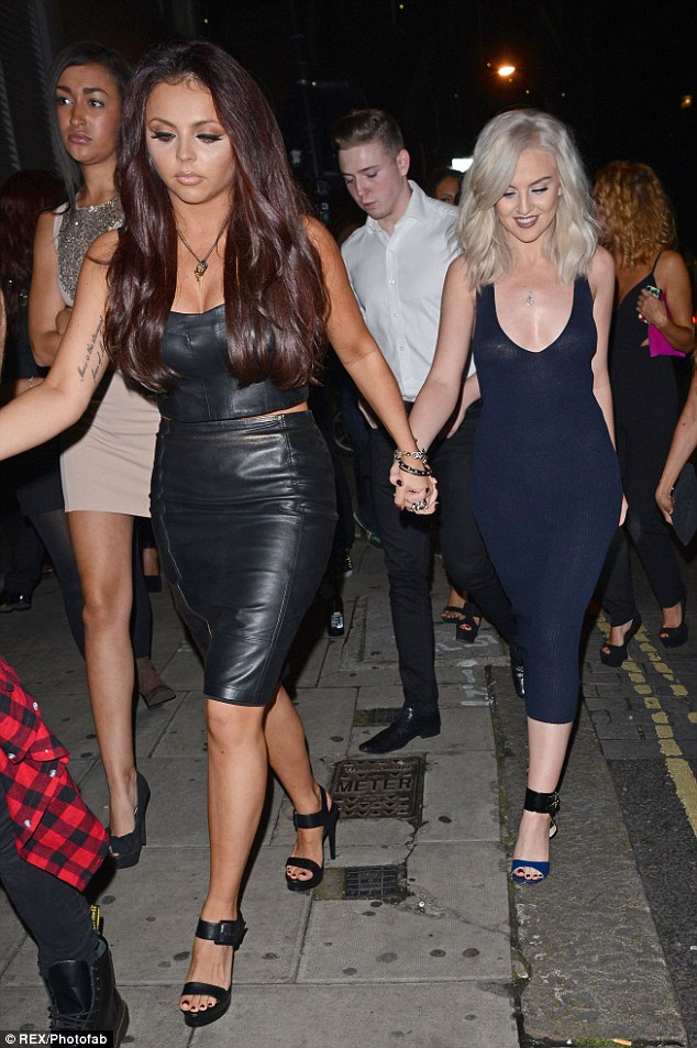 Lady in leather: Jesy turned heads in her tight leather dress which showing off her cleavage and a touch of midriff