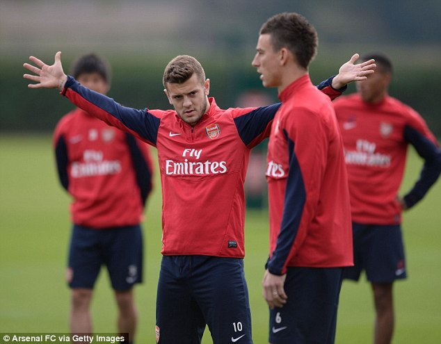 Bit of a stretch: Wilshere was in good spirits during training at London Colney as Arsenal prepare for their trip to West Bromwich on Sunday
