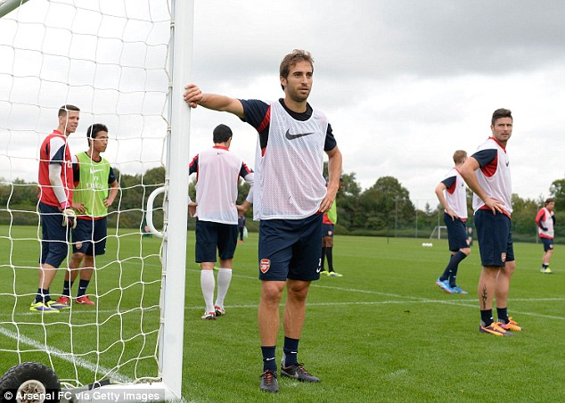 Taking guard: Mathieu Flamini patrols the near post during a training game