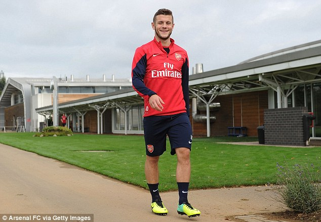 Back in business: Jack Wilshere trained with Arsenal on Saturday morning for the first time since manager Arsene Wenger criticised him for smoking on a night out (below)