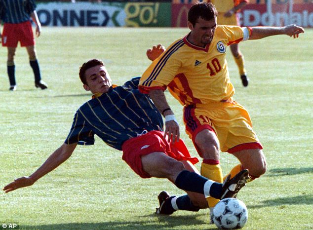 Happy returns: Former Romania and Barcelona star Gheorghe Hagi (right)