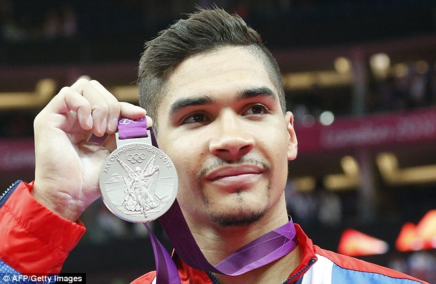 Day job: Smith with his silver medal he won in the men's pommel horse at the London Olympic Games