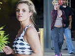 That hard work is paying off! Britney Spears shows off her toned abs in tiny crop top during another grueling workout