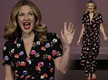Feeling fine in floral! Beaming Drew Barrymore brightens up the Jay Leno set in a fun colourful jumpsuit in her favourite flower print