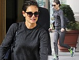 What up Holmes! Katie wears leather trousers with high-top trainers as she runs for a taxi cab
