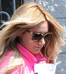 You won't miss her! Ashley Tisdale heads to the studio in a bright pink top