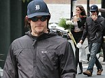 Norman Reedus shares a joke with a mystery woman in Soho, New York