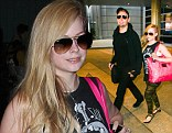 Sk8er Boi or girl? Avril Lavigne arrives back from China with husband Chad Kroeger amid rumours she might be pregnant