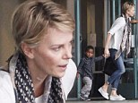 Charlize Theron wears scarf to cover incision on her neck following surgery for broken vertebra