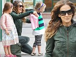 Mother to the rescue! Sarah Jessica Parker bundles up her daughter Marion against the autumn chill on city stroll