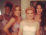 Here comes the bride! Kelly Clarkson dons gorgeous wedding dress while performing her Christmas song on The View