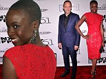 Man of honour Ralph Fiennes looks suave at his New York Film Festival Gala Tribute... but he's upstaged by The Walking Dead star Danai Gurira