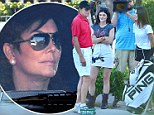 The show must go on: Kendall and Kylie Jenner are filmed golfing with dad Bruce as split is announced while Kris talks business with Kim, Khloe and Kourtney