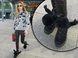 Cara Delevingne jets home from Brazil sporting furry gorilla trainers and skinny leather trousers