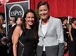 Congrats! Soccer power couple Abby Wambach and Sarah Huffman wed Saturday in a sunset ceremony on a Hawaii beach