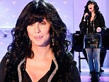 Cher, 67, looks remarkably youthful as she shows off her toned thighs in a leather mini skirt