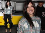 Daisy Lowe keeps out the cold in fluffy tartan jumper and cropped trousers as she models at Vogue's Fashion Night Out