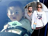 What were you thinking? Alessandra Ambrosio's fiance Jamie Mazur drives down street with their 17-month-old son on his lap