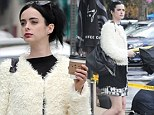 Krysten Ritter beats the chill in statement faux fur jacket as she enjoys a solo stroll in the rain