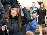 Elizabeth Hurley perches on a step as she films scenes for new show The Royals
