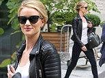 Striding up a storm! Rosie Huntington-Whiteley is runway ready in leg-lengthening jeans and fierce boots