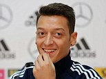 Smiles better: Ozil talks to the German media in Cologne on Thursday