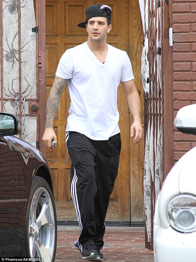 Hip hop style: Mark Ballas strolled up to the studios wearing a flat billed cap and loose track joggers