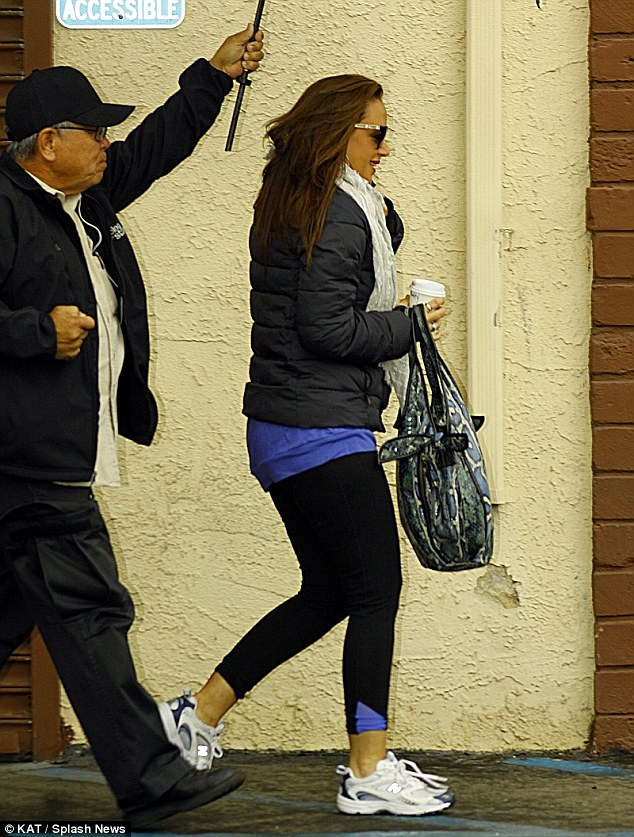 Hurrying: The actress scurried to her rehearsal as she carried a to go cup of coffee