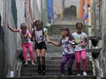 Potential targets in a sickening trade: Girls play in Medellin, Colombia, where street gangs are selling virgins to drug lords and foreign tourists (none of the children here were affected)