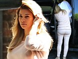She's back in shape! Kim Kardashian looks pretty in baby pink for an outing with Kanye West and daughter North