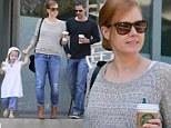 I want one too, Mom! Amy Adams' daughter Aviana gets her very own Starbucks cup during family coffee run
