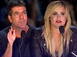 'Shh, Demi the grown-ups are talking!' Simon Cowell scolds Lovato on The X Factor after she questions the strength of couple Alex & Sierra's love