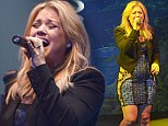 Kelly Clarkson hits a fashion low note in unflattering tight dress for performance at Fair Trade charity concert
