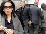 Same diet plan? Hilaria and Alec Baldwin were both seen carrying green drinks as they headed out of their apartment in New York's West Village on Thursday