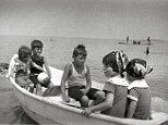 Sea voyage: (Left to right) Eunice, Jack, Joe Jr., Rosemary, and Kathleen relaxing in a boat off Sandy Beach in the early 1920s