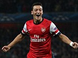 Top Gunner: Mesut Ozil has been a revelation for Arsenal but came close to being a Manchester United player