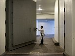 Immense Protection: Chef Richard Rosendale opens a blast door while walking to his kitchen in The Bunker below the Greenbrier Resort January 10, 2013 in White Sulphur Springs, West Virginia