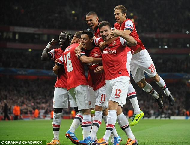 Magic moment: Ozil's goal-creating ability impressed Gunners fans, then he scored the winner against Napoli