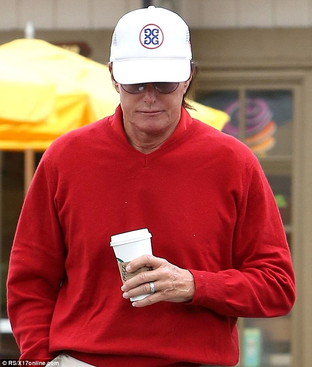 Ring on: Bruce was wearing his wedding ring as he grabbed a cup of coffee in his golfing outfit
