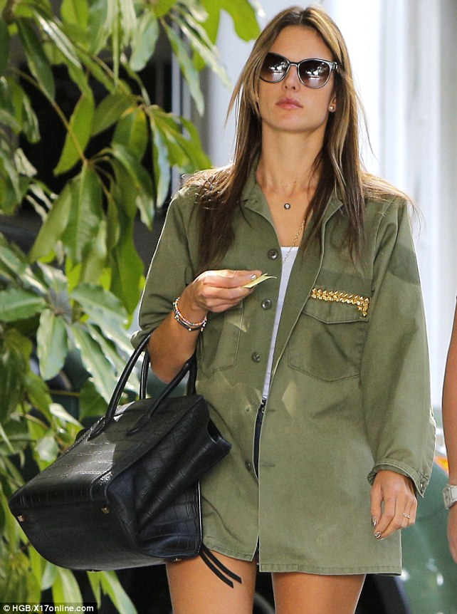 Simply stunning: Alessandra rocked an olive jacket and tiny short and kept cool in sunglasses