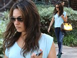 The moody hues...Downcast Mila Kunis wears three shades of blue for a day out with friends