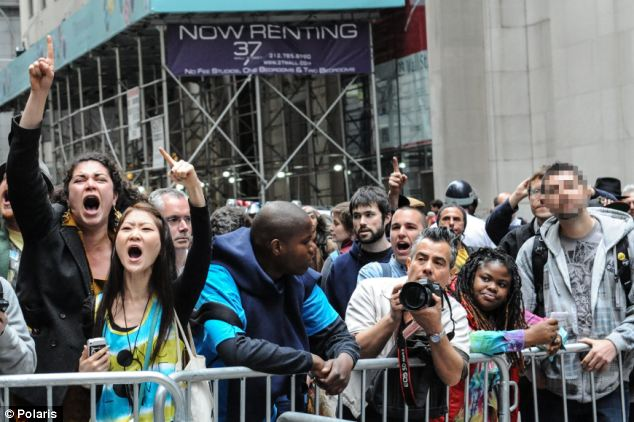 In the frame: Braszczok has been identified in this picture from a protest on Wall Street in April last year